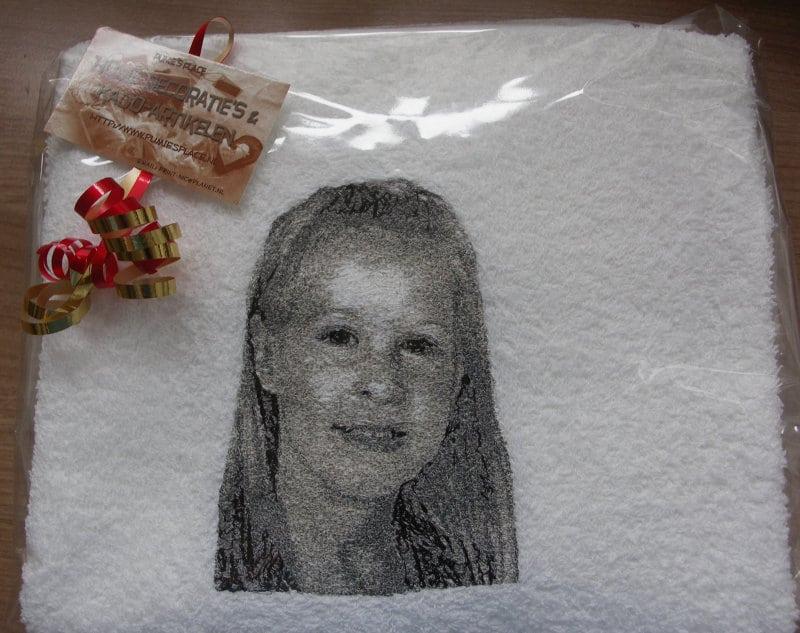 Foto geborduurd op handdoek